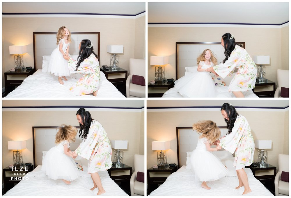 Adorable bride and Flower girl jumping on the bed  Wedding photo inspiration