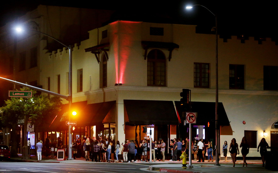 The line to get into Aurea Vista Bar & Night Club goes around the building Saturday night, Aug. 19.