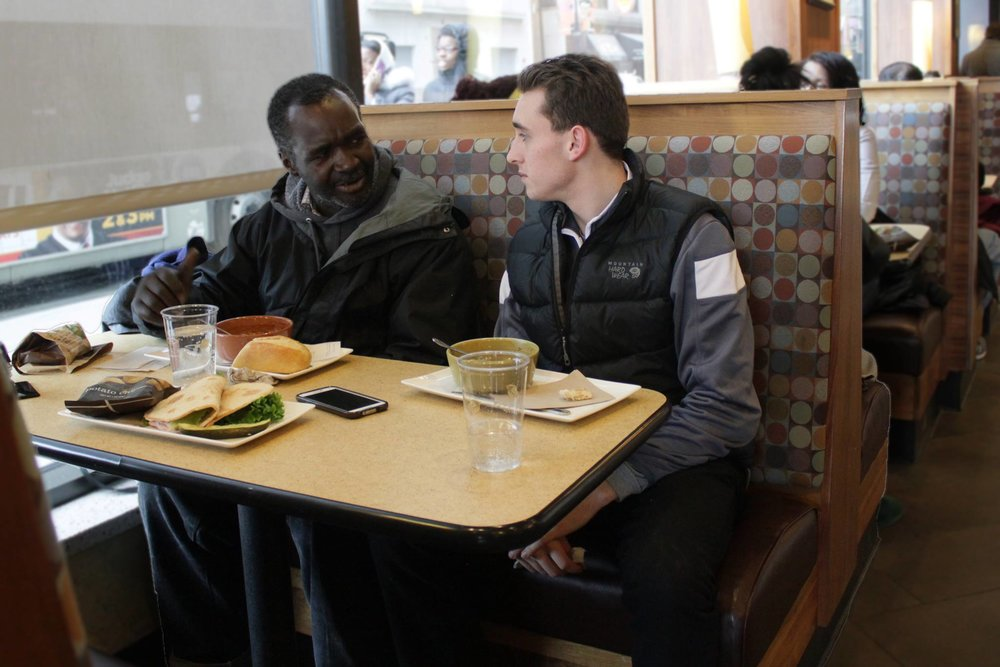 Raymond Ferguson (left) dines with a member of nonprofit SPARK (Students Performing Acts of Random Kindness) in 2015.