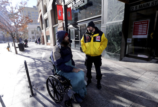 A homeless man approaches Jared Arvanitas, Downtown Ambassador program manager, to ask for assistance in downtown Salt Lake City on Tuesday, Dec. 4, 2018. (Photo: Kristin Murphy, KSL)