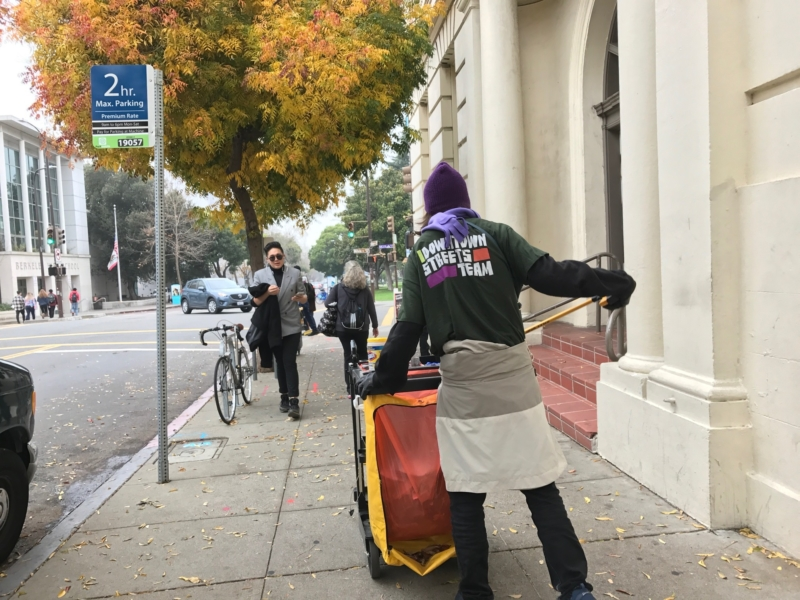 Downtown Streets Team member Leona starts a shift cleaning sidewalks. The program provides skills and work experience to help people who are homeless, or at-risk of becoming homeless, get paid jobs. Photo: Kate Rauch