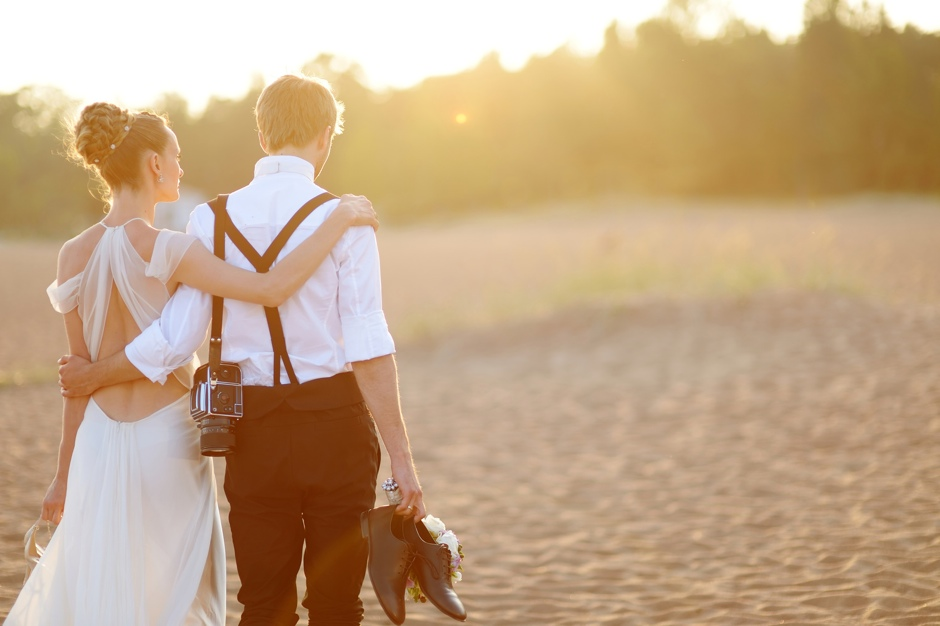Bride and groom on a beach at sunset ©MNStudio
