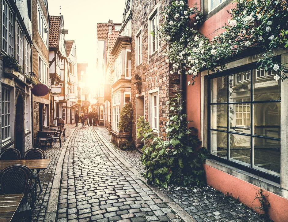 Historic street in Europe at sunset with retro vintage effect© JR Photography