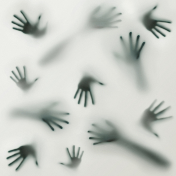 Frightening silhouette of many different hands