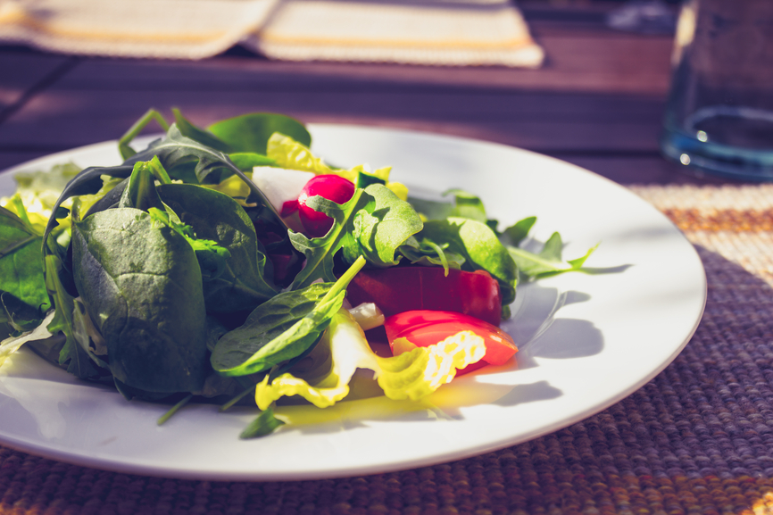 Salad on plate outdoors on a sunny day