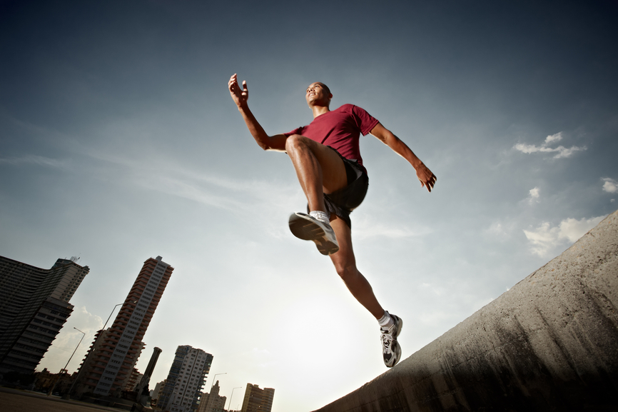 Man running and jumping from a wall