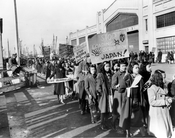 A group of Chinese demonstrators at the waterfront in San Francisco carrying signs protesting the sale of scrap iron to Japan. December 20, 1938. Photographer unknown. Gelatin silver print. Collection of Oakland Museum of California.