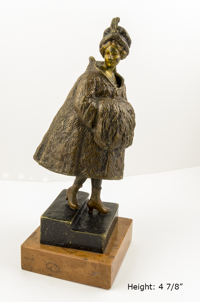 This Vienna bronze of a well-to-do WWI era woman hides a secret