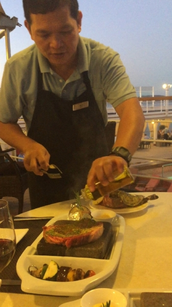 Where else can you cook amazing food on a volcanic rock while sitting on the deck of a luxurious ship?