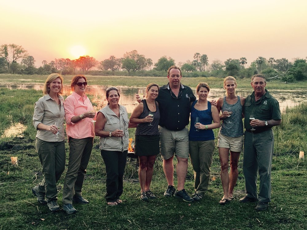 The perfect ending to a day safari in the Okavango Delta - sundowner cocktails at the water's edge with friends and incredible guides.