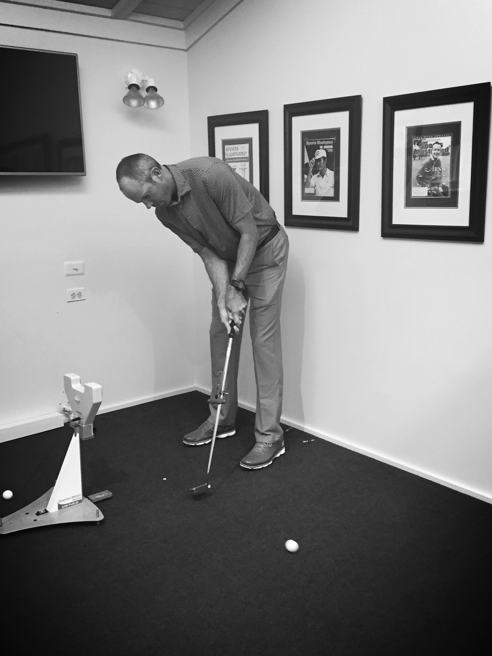 PGA Tour player Matt Kuchar checks his stroke at the Caves Valley Performance Center.