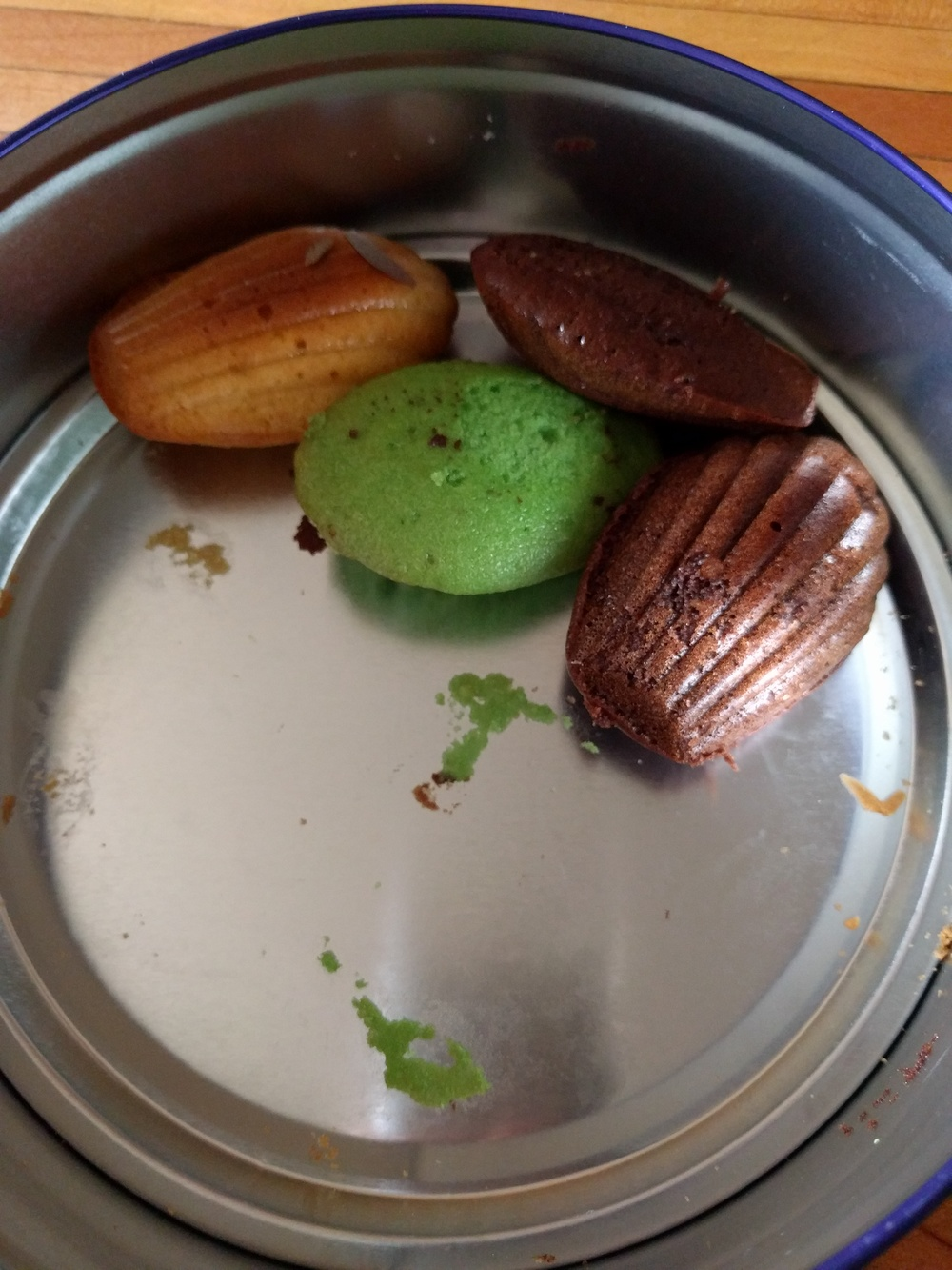 What's leftover of orange-, pandan- and chocolate-flavored madeleines. Of course they disappeared after I took the picture. Credit: Grace G Lau