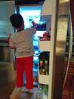 Son raiding the refrigerator