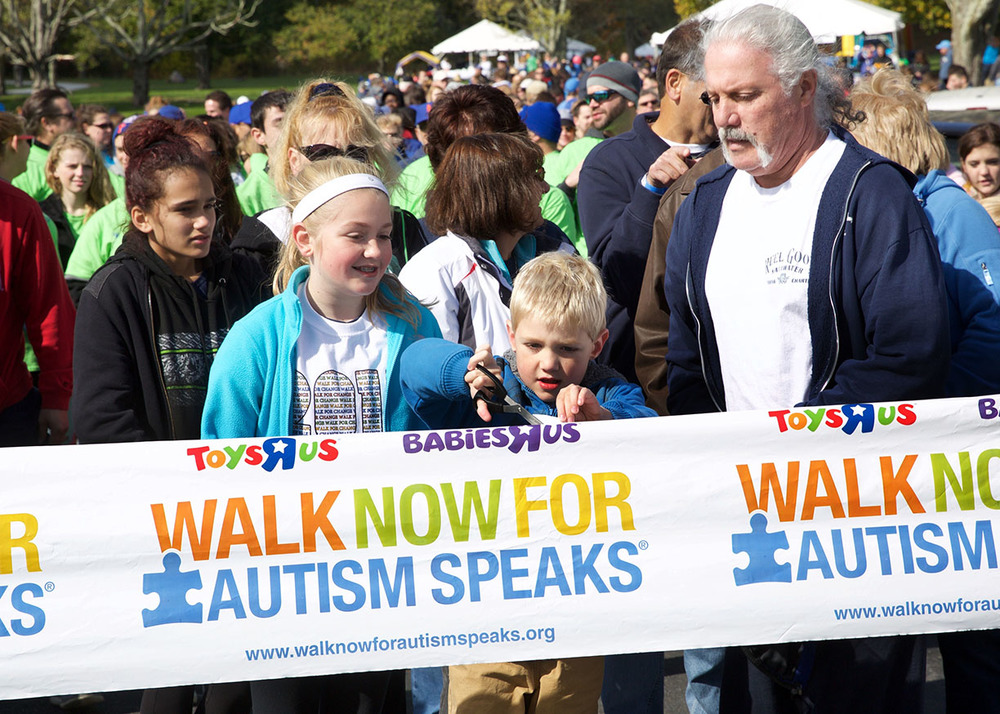 Autsim speaks ribbon cutting to start walk.jpg