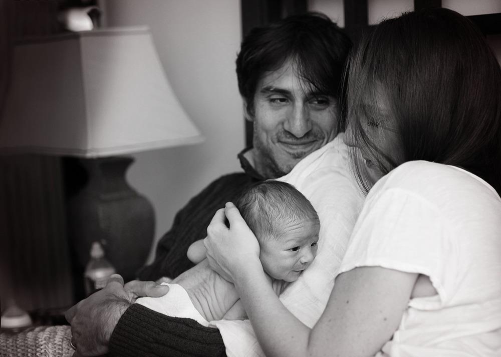 Father's loving look at wife newborn.jpg
