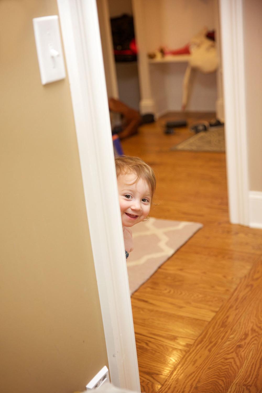 little girl peeking around the door.jpg