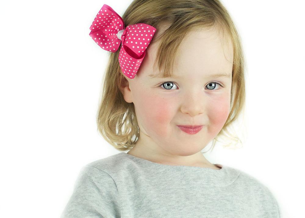 Child Actor Headshot_Stamford CT_Little girl pink bow.jpg