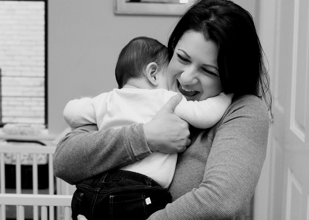 Black and white hug mother baby.jpg