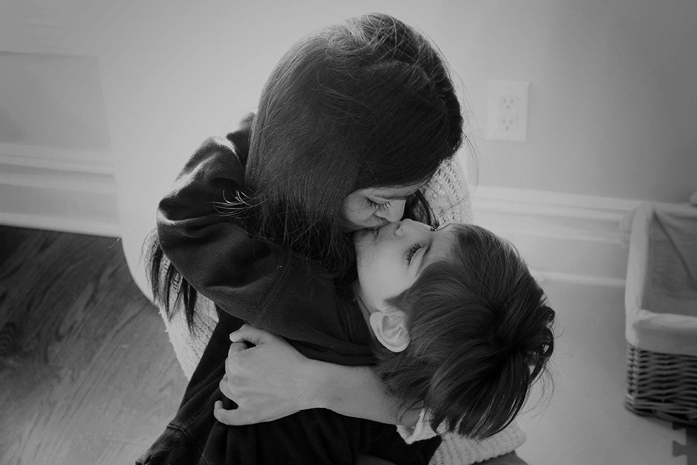 Mother son kiss at home candid Rye family photographer.jpg
