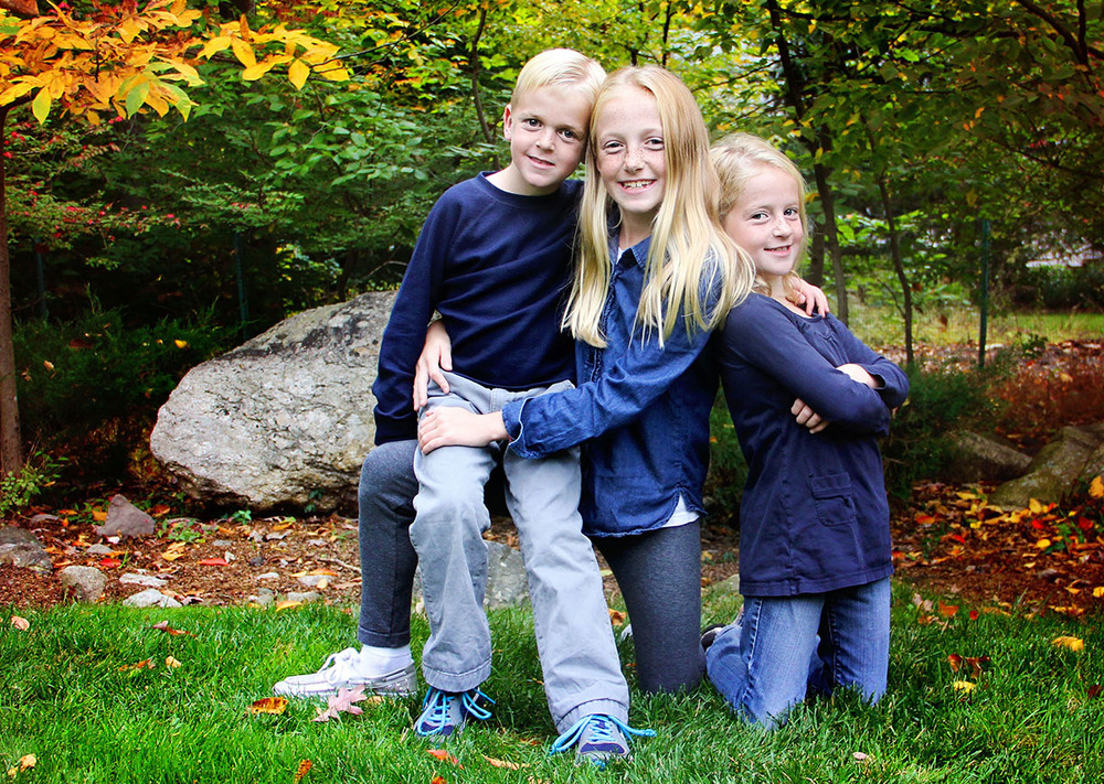 Fall family photos bright leaves in the park Connecticut.jpg