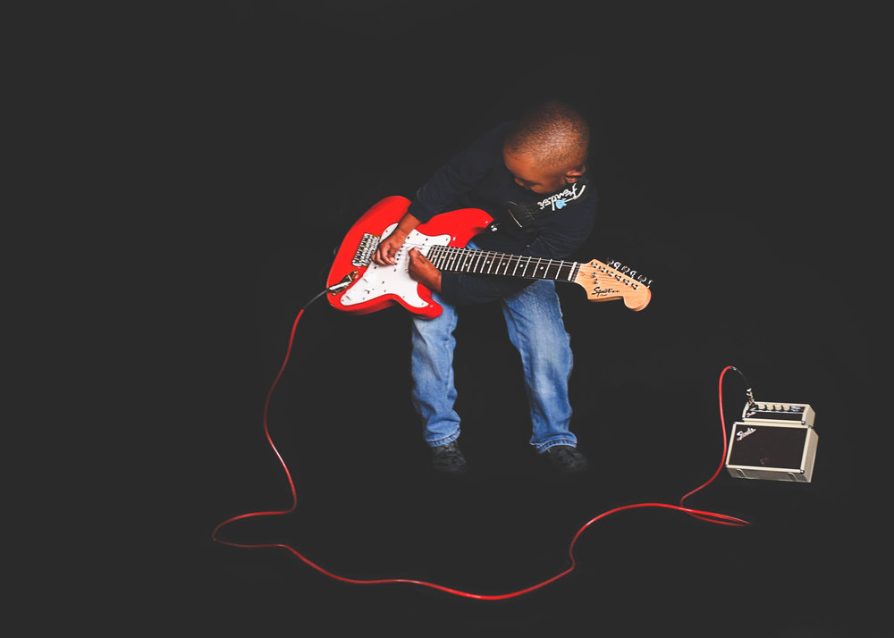 Boy with fender guitar prodigy NYC.jpg