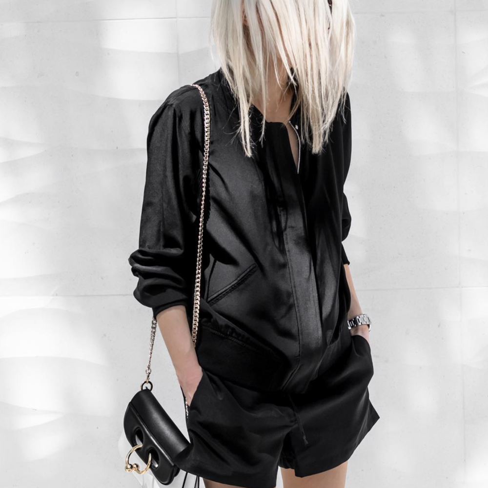 Blogger @figtny in the black Silk Bomber Jacket & Silk Shorts