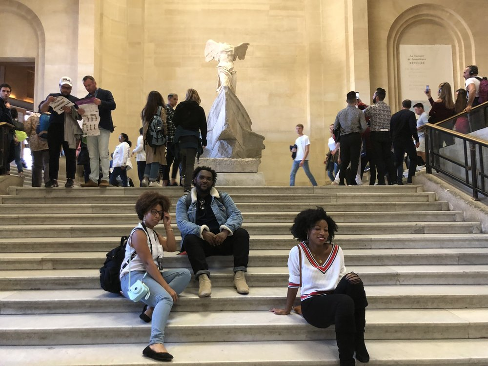 All you have to do to get a staircase to yourself in the Louvre is be black and sit down
