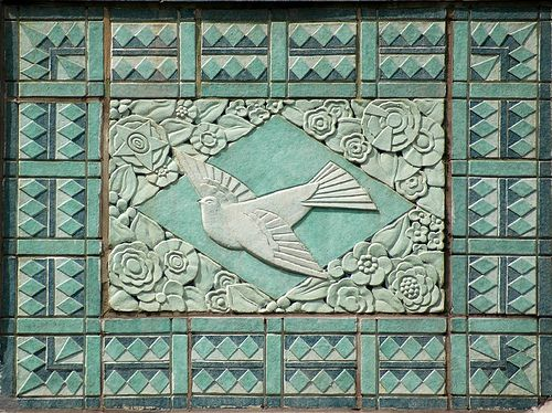 Turquoise Bird Motif on Art Deco Building