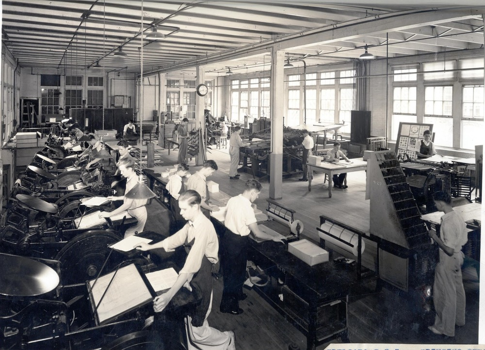 Students in 1921 learning how to use a printing press.  Photo source: Delgado90.com