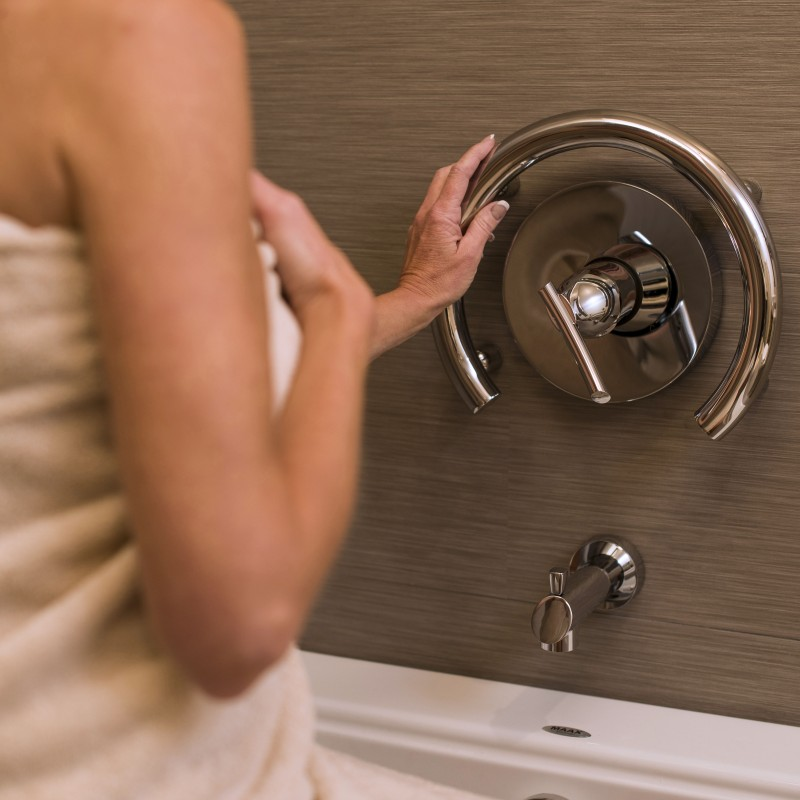 Courtesy Invisia - A shower ring, instead of two grab bars, and it does the same thing with more human function in mind instead of a straight bar.