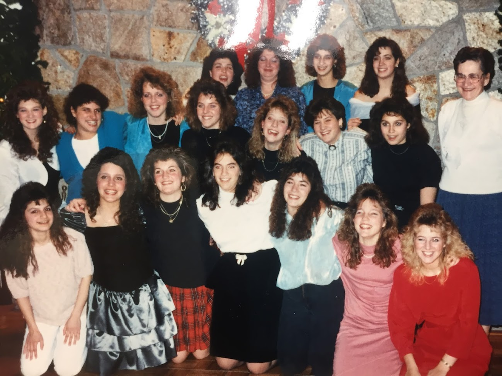 This was an 80's (you can tell by the big hair) Christmas party with a lot of WTN students.This was most of the front end cashiers.