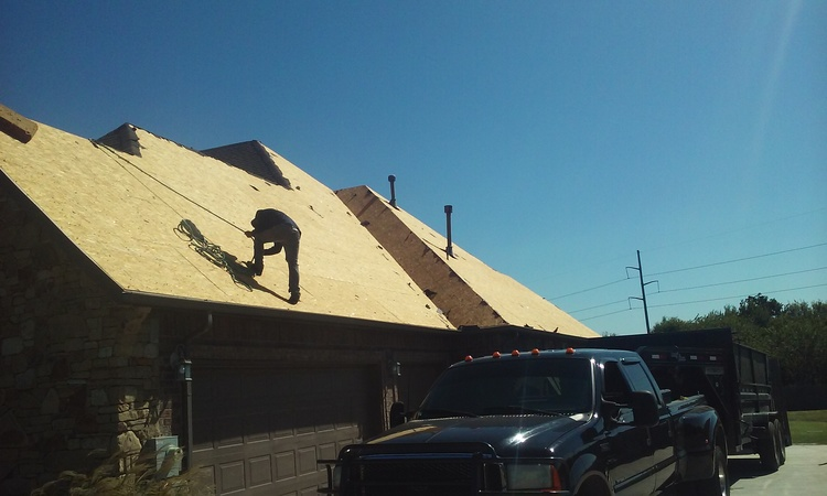 roofers on steep roof