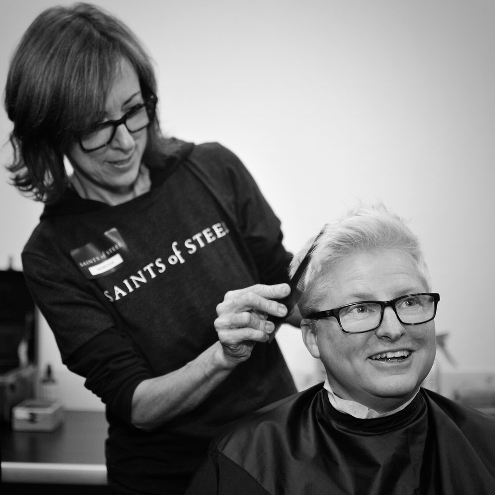 Rebecca, founder of Haircuts with Heart + owner of Shine Forth Salon, supporting us @ the SF LGBT center. Photo by Sarah Karlan