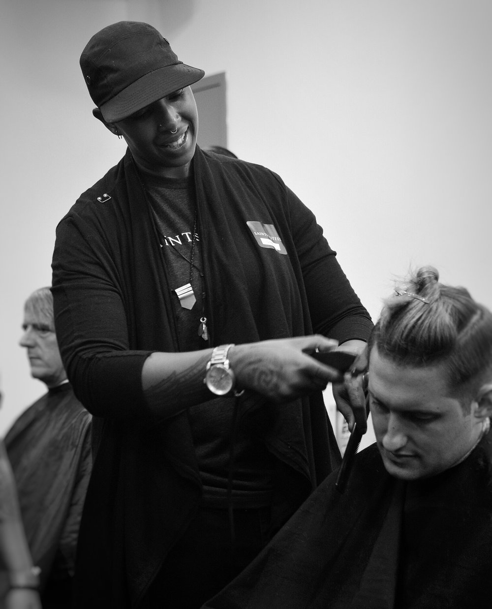 Christian giving another amazing haircut @ the SF LGBT center. Photo by Sarah Karlan
