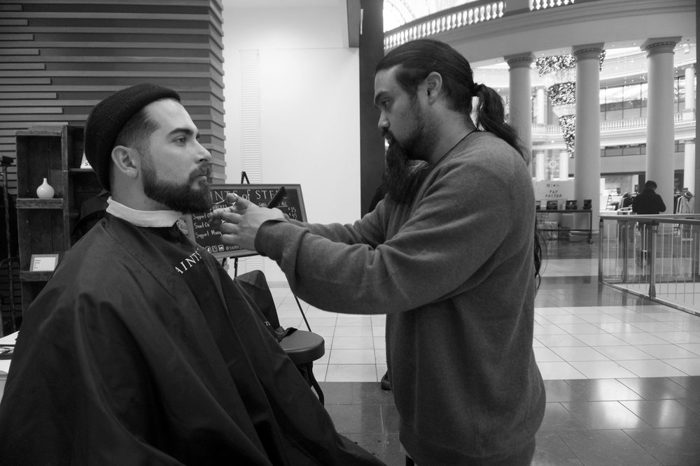 Jay giving a Saint One Support One beard trim to Mark at the Saints of Steel pop-up charity barbershop @ Westfield San Francisco Centre's Bespoke Demo. Photo by Ryan Anthony