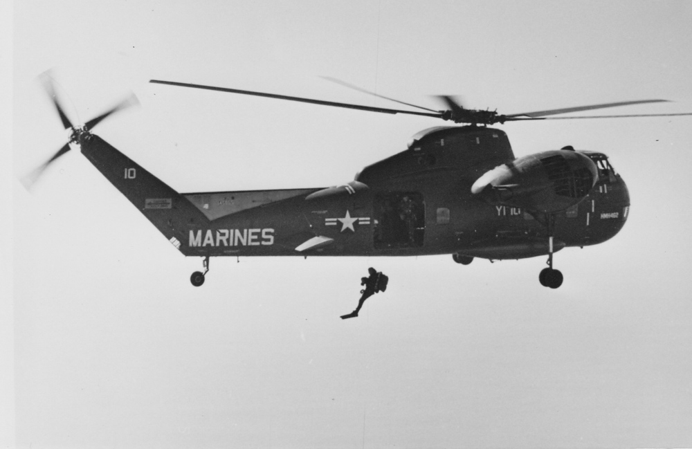 Jumping from the helicopter, in full dive gear, during Marine Force Recon training.