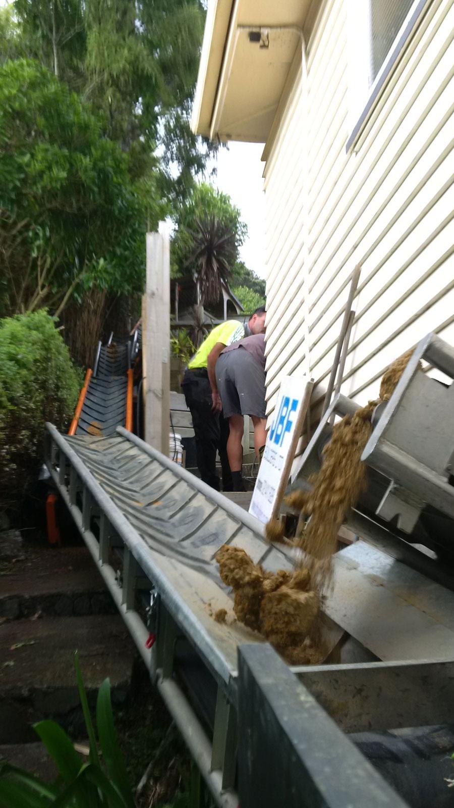 Soil conveyor belt system for tite site