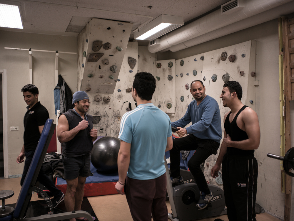 Riksgränsen, Sweden. February 2nd, 2016. Refugees with different nationalities work out together at the gym inside the resort.