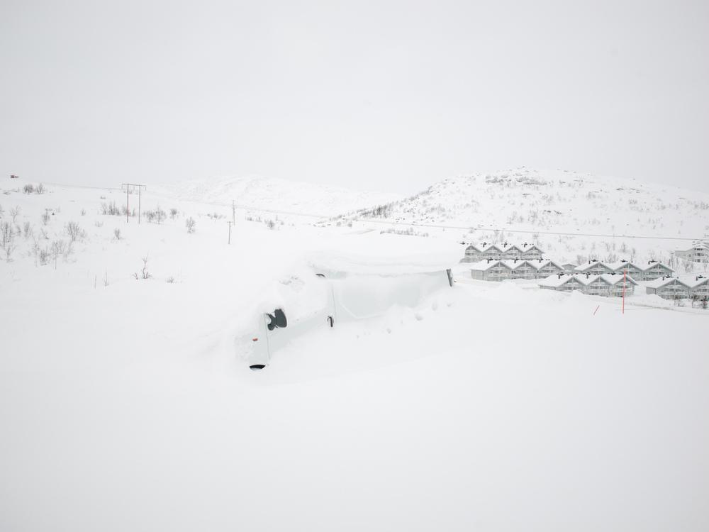 Riksgränsen, Sweden. February 2nd, 2016. A white van covered in snow.