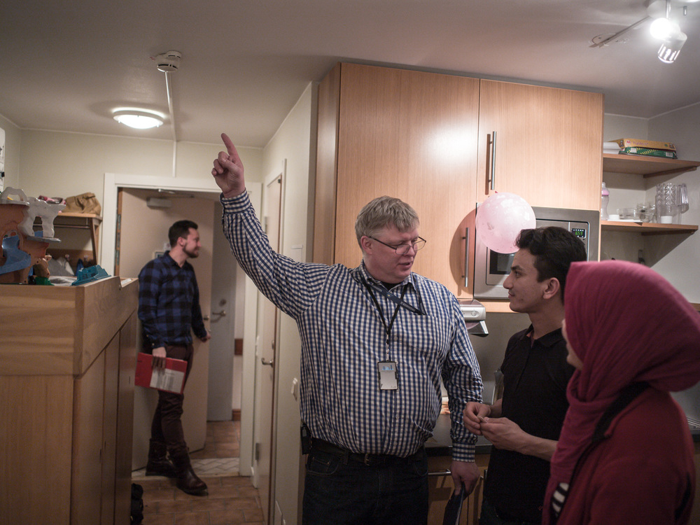 Riksgränsen, Sweden. February 2nd, 2016. A representative from the Migration office jokes with Mahdi and Zakera.
