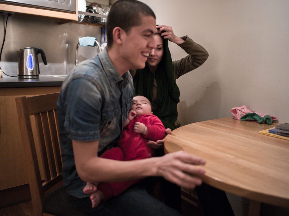 Riksgränsen, Sweden. February 2nd, 2016. Mahmoud (left) and Khadije (right) with their baby. They arrived in Sweden, from Afghanistan, in October 2014