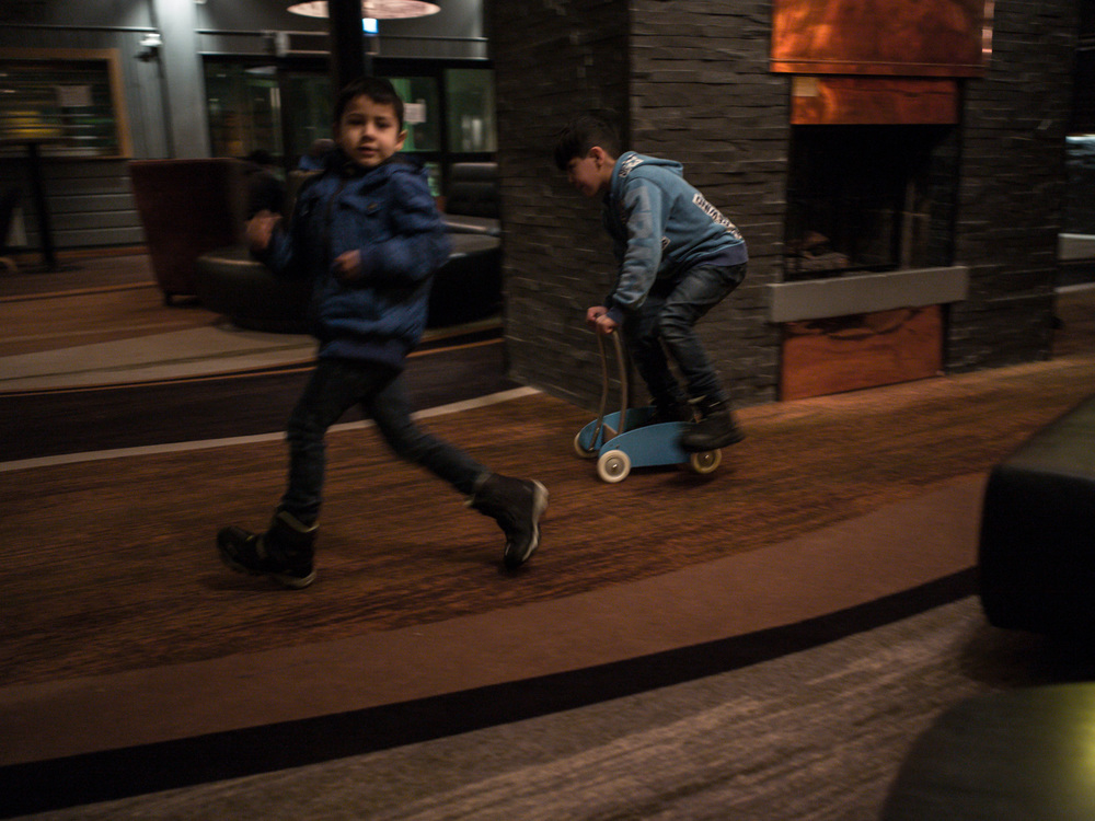 Riksgränsen, Sweden. February 2nd, 2016. Children, chase each other aroung the foyet, the circular corridor pathway around the fireplace, acts as their race track.