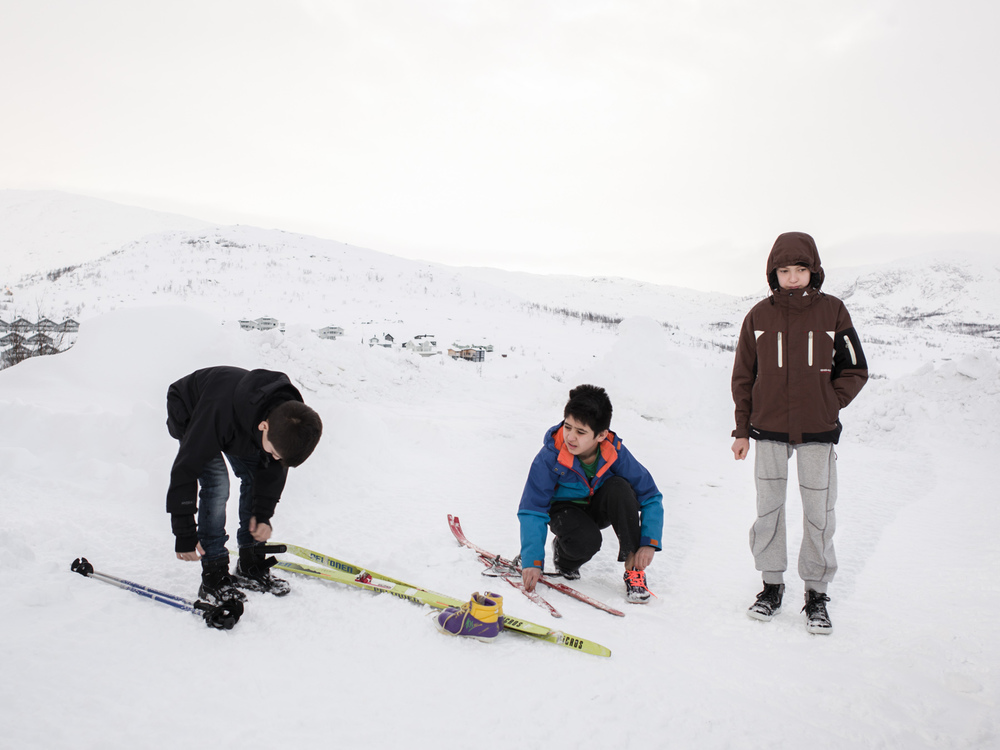 Riksgränsen, Sweden. February 3rd, 2016. Three boys from Afghanistan prepare for a bit of skiing.