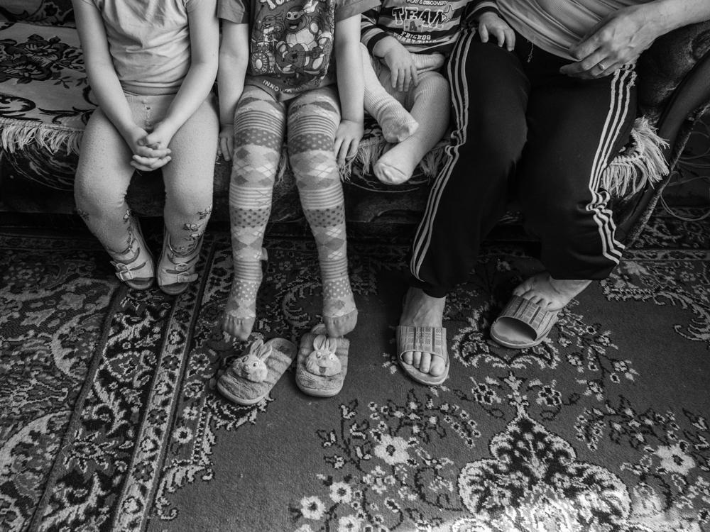 HIV+ woman and her three children. Kramatorsk, Ukraine. April 8th, 2016.