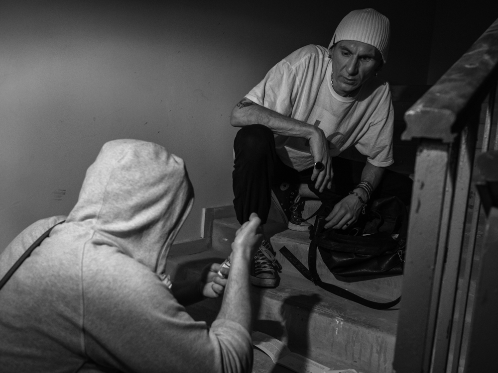 Roman and Konstatin preparing the methadone for injection in the 'shooting gallery'. Kyiv, Ukraine. April 17th, 2016.
