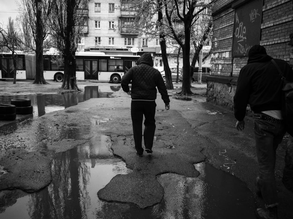 Roman and Konstantin on their way to deposit money to the dealer. Kyiv, Ukraine. April 15th, 2016.