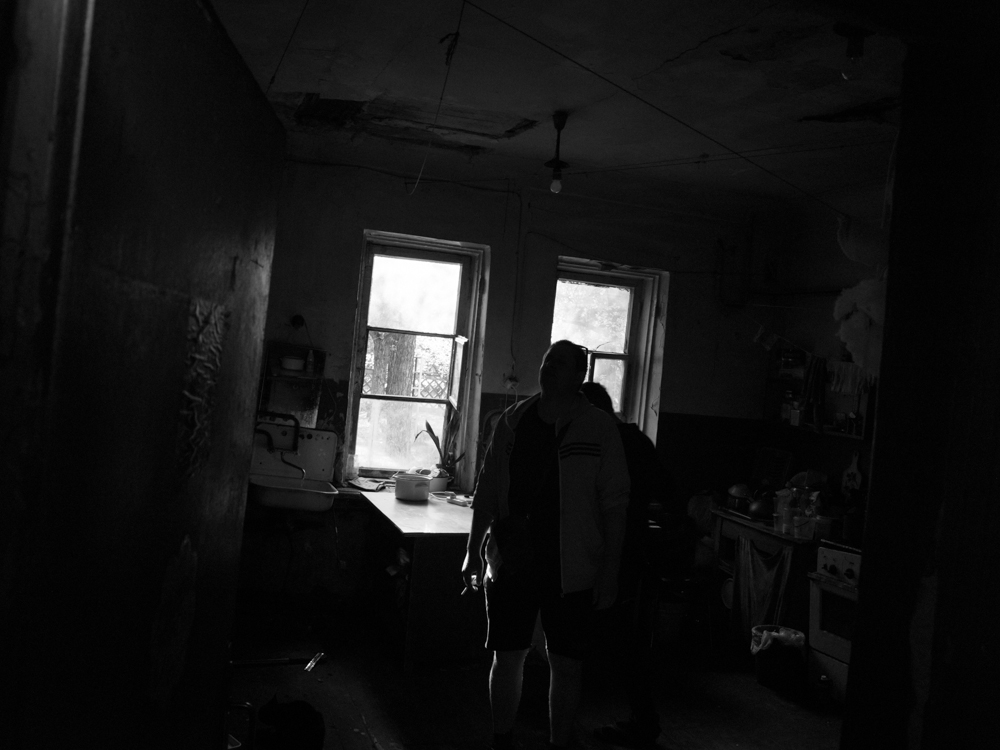 Roman 'peaking' inside the kitchen of the dealer's house. April 17th, 2016.