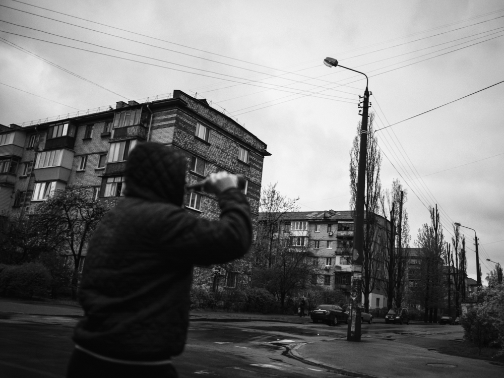 Roman drinks a beer on his way to the dealer. Kyiv, Ukraine. April 15th, 2016.