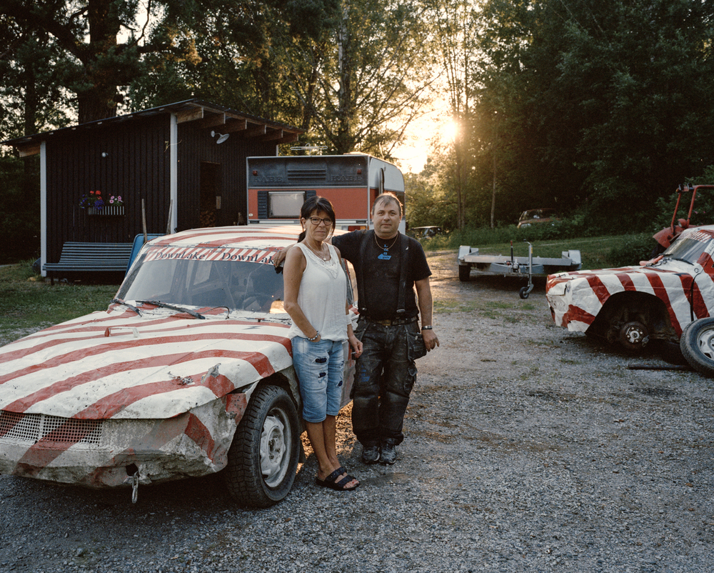 Torpshammar, Sweden, July 5th 2016. Local couple Eva Nordin and Tomas Persson. They, like many in the area, are car enthusiasts, spending their free time fixing up old cars to race on the weekends.