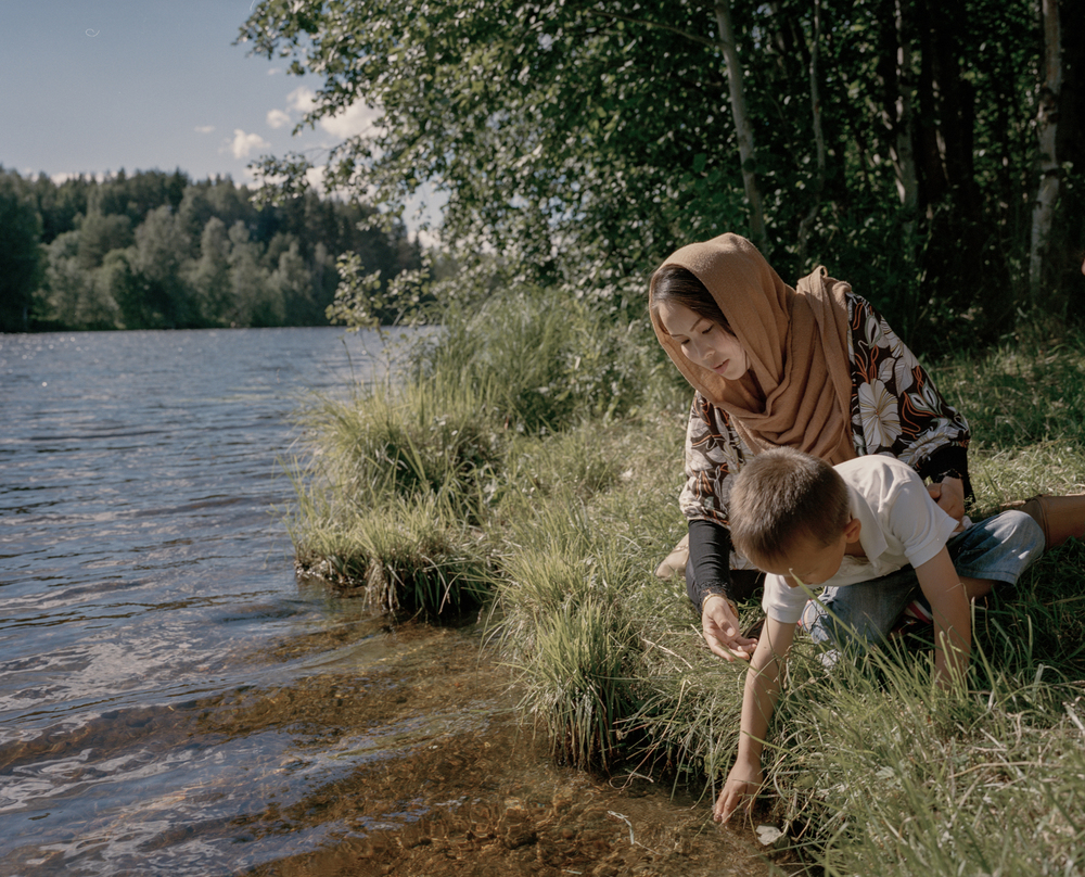 Torpshammar, Sweden. July 5th, 2016. Zakera, 24, and her son Taha, 3, spending time by the river 'Ljungan' at a spot close to the temporary housing for refugees.